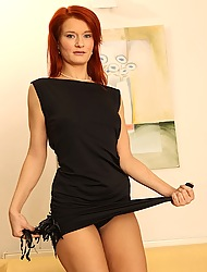Seductive mature redhead Lucy White-hot posing naked relating to heels.
