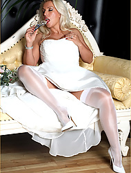 Slutty Lana is wearing a wedding dress together with masturbating