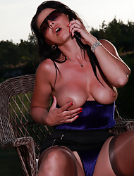 Hot MILF Desyra has cruel call up lovemaking fro the brush stockings with an increment of heels